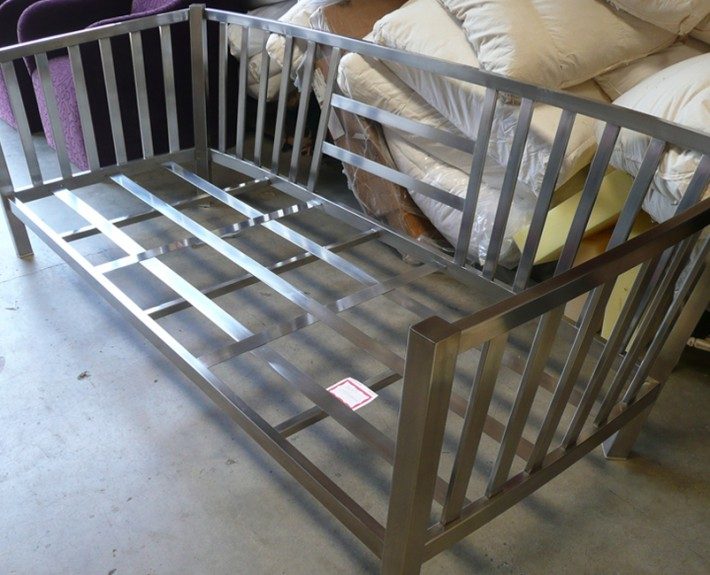 Stainless steel couch frame at upholstery shop for pillow fitting
