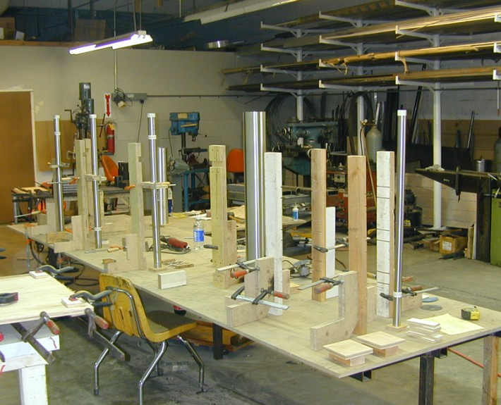 Making legs for stainless steel | glass desk in McCalley facility